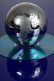 Globe puzzle with CD Stock Images