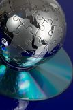 Globe puzzle with CD Royalty Free Stock Photo