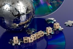 Globe puzzle with CD Stock Photos