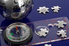 Globe puzzle with compass Stock Image