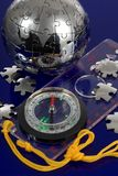 Globe puzzle with compass Stock Images