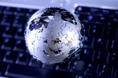 Globe puzzle on keyboard Stock Image