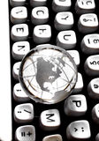 Globe on QWERTY Royalty Free Stock Image