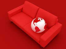 Globe and red sofa Royalty Free Stock Image