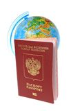 Globe and Russian international passport isolated on white Royalty Free Stock Photography