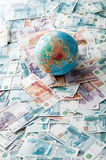 Globe on Russian money Royalty Free Stock Images