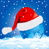 Globe in a Santa Claus hat. Vector. Stock Image