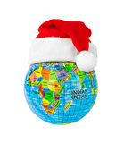 Globe and Santa Claus red christmas hat Royalty Free Stock Photo