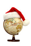 Globe with Santa Hat. Santa hat on a globe with Australia, China and India facing out.  Isolated on white Stock Images