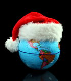 Globe Santas hat. Royalty Free Stock Photos