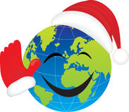 Globe with Santa's hat. Stock Images