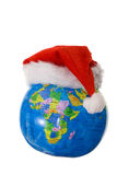 Globe with Santa's hat Royalty Free Stock Photography