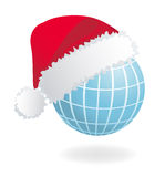 Globe with Santa's red hat Stock Image