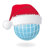 Globe with Santa's red hat Stock Photo