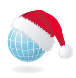 Globe with Santa's red hat Stock Photography