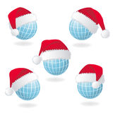 Globe with Santa's red hat Royalty Free Stock Photos