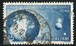 Globe and Satellites. ITALY - CIRCA 1956: stamp printed by Italy, shows Globe and Satellites, circa 1956 stock image