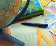 Globe & school accessories. Still-life about school accessories for a lesson of geography Stock Images