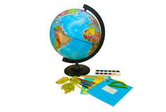 Globe and school supplies Stock Image
