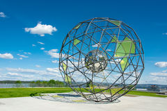 Globe shaped metallic sculpture Stock Photo