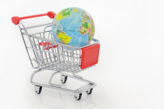 Globe in shopping cart Royalty Free Stock Photos