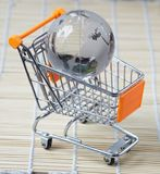Globe shopping cart concept Stock Images