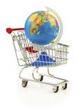 Globe in the shopping cart Stock Photo