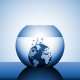 A globe sinking in water Royalty Free Stock Image