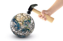 Globe smash with a hammer, isolated on a white background. Elements of this image furnished by NASA Stock Images