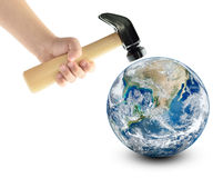 Globe smash with a hammer, isolated on a white background. Elements of this image furnished by NASA Royalty Free Stock Photo