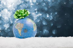 Globe in the snow with starry background Royalty Free Stock Images