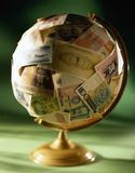 Globe on soft money glue Stock Photos