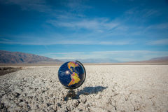 Globe Sphere in Waste Desert Royalty Free Stock Image