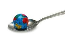 Globe in Spoon Stock Image