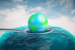 Globe on spoon Royalty Free Stock Image
