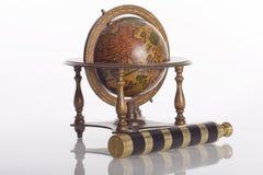 Globe and spyglass Stock Photos