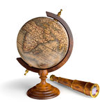 Globe and spyglass Stock Photo