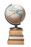 Globe on a stack of books Stock Photo