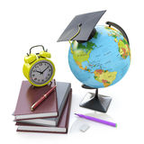 Globe, stack of school books with alarm clock and ball pens. Sch Stock Images
