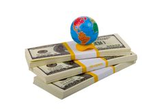 Globe on stacks of dollars Royalty Free Stock Photography