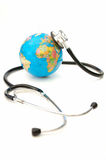 Globe and stethoscope. Stethoscope on top of an atlas globe Royalty Free Stock Images