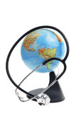 Globe and Stethoscope Stock Photography