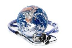 Globe with stethoscope Royalty Free Stock Image