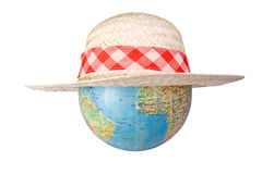 Globe in straw hat Stock Photos