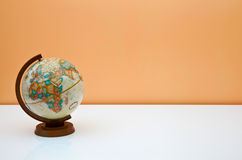 The globe on the students desk. With place for text Stock Image
