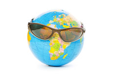 Globe with sunglasses isolated Stock Photos