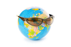 Globe with sunglasses isolated Royalty Free Stock Photography