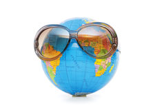 Globe with sunglasses isolated Stock Photo