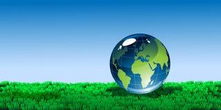 Globe sur l'herbe Photographie stock