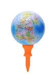 Globe sur le té de golf orange photographie stock